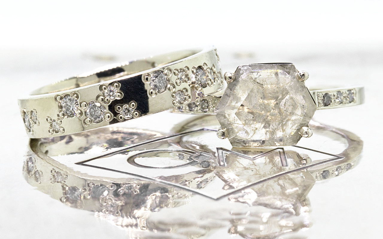 1.04 carat fancy-cut light champagne and rustic white prong set diamond ring with six 1.2mm gray diamonds set in band set in 14k white gold flat band. With Organic Wedding Band with brilliant white and gray diamonds 4mm wide and 1.5mm thick flat band