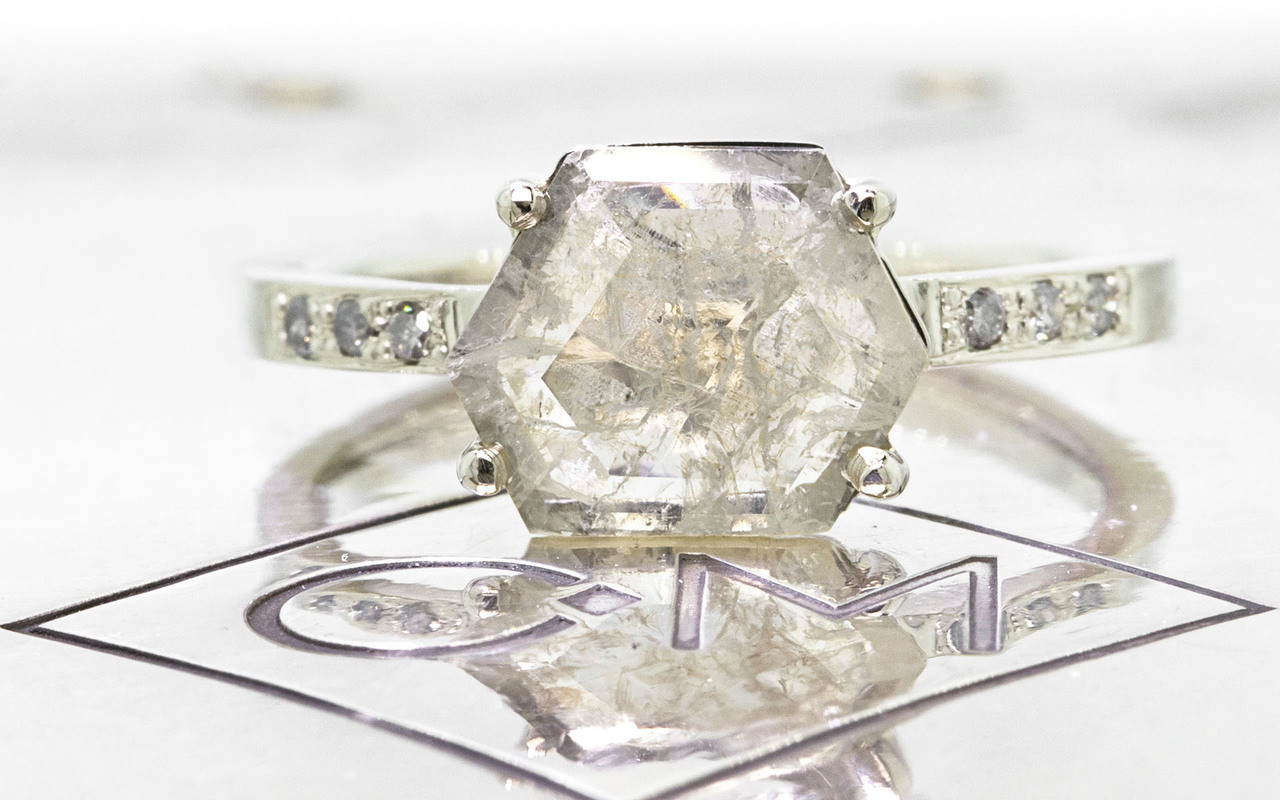 1.04 carat fancy-cut light champagne and rustic white prong set diamond ring with six 1.2mm gray diamonds set in band set in 14k white gold flat band. Front view on metal background with Chinchar/Maloney logo