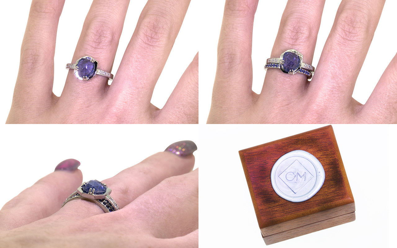 KIKAI 1.37 carat free form rose cut blue sapphire with six 1.2mm brilliant white diamonds set in band set in 14k white gold flat band. With wedding band with 16 blue sapphires set in 14k white gold on a hand with wooden ring box stamped with wax seal Chinchar/Maloney logo. Part of our New Classic Collection
