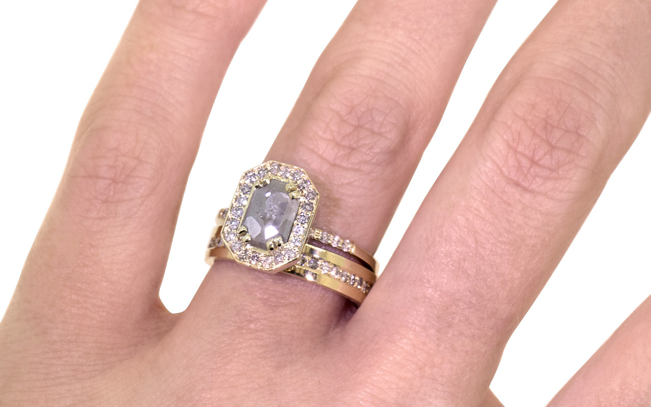 KATLA New Classic .60 carat fancy cut gray diamond prong set in octangualr  14k yellow gold setting with brilliant, gray diamonds surround the center diamond in a halo as well as each corner of the setting and each shoulder of the ring. shown on hand with  14k yellow gold CM eternity diamond wedding band.