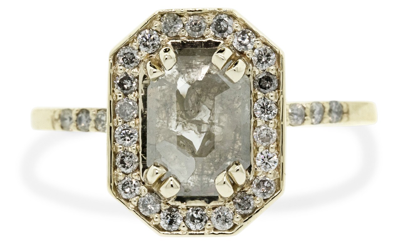 KATLA New Classic .60 carat fancy cut gray diamond prong set in octangualr  14k yellow gold setting with brilliant, gray diamonds surround the center diamond in a halo as well as each corner of the setting and each shoulder of the ring.