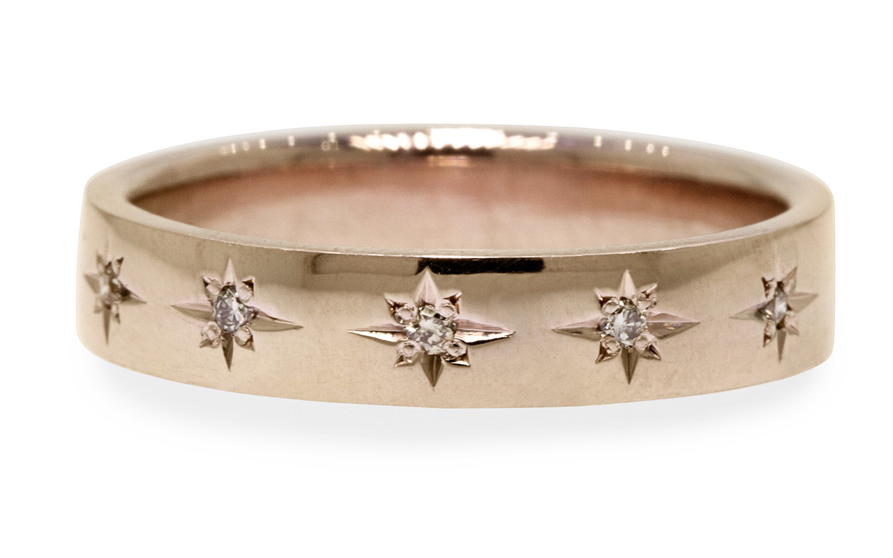 14k yellow gold wedding band with brilliant champagne diamonds set in star detail half way around band. On white back ground