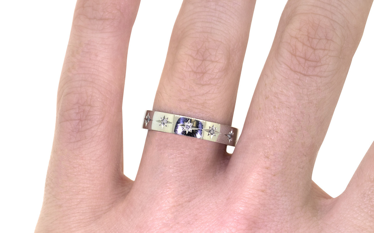 14k white gold wedding band with brilliant gray pave diamonds set in star detail modeled on hand