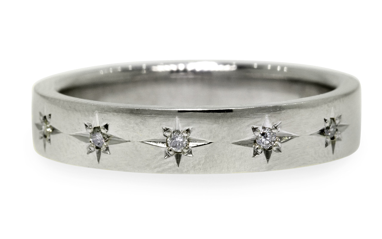 14k white gold wedding band with brilliant gray pave diamonds set in star detail. On white back ground