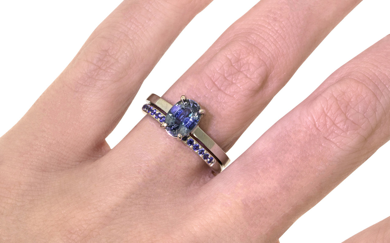 1.59 carat oval rose cut blue sapphire set in 14k white gold flat band. With Wedding band with 16 blue sapphires set in 14k white gold on a hand