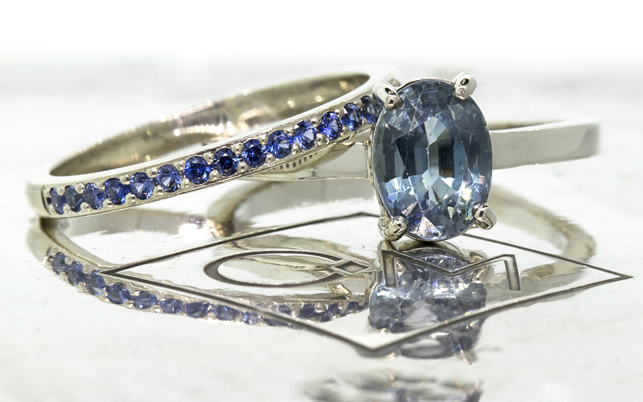 1.59 carat oval rose cut blue sapphire set in 14k white gold flat band. With Wedding band with 16 blue sapphires set in 14k white gold