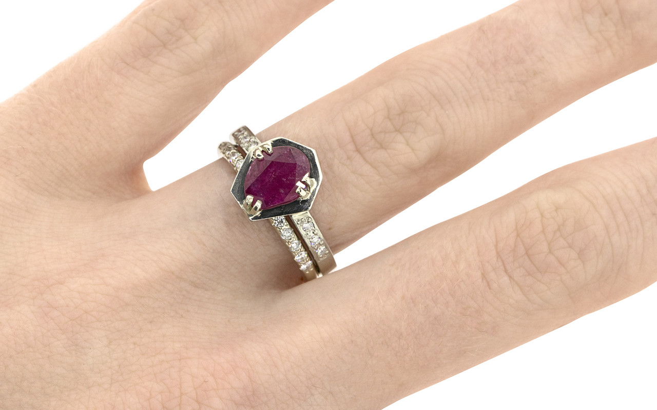 KIKAI .84 carat ruby in 14k white gold six 1.2mm brilliant white diamonds set in band with 14k white gold Wedding Band with 16 white Diamonds on a hand from New Classic Collection