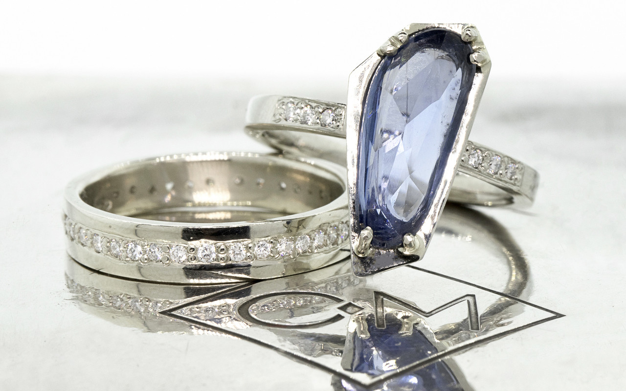 KIKAI 2.46 carat free-form, rose cut blue sapphire with 6 1.2mm brilliant white diamonds set in band set in 14k white gold flat band. with Eternity Wedding band with brilliant white diamonds set in 14k white gold. Part of New Classic Collection