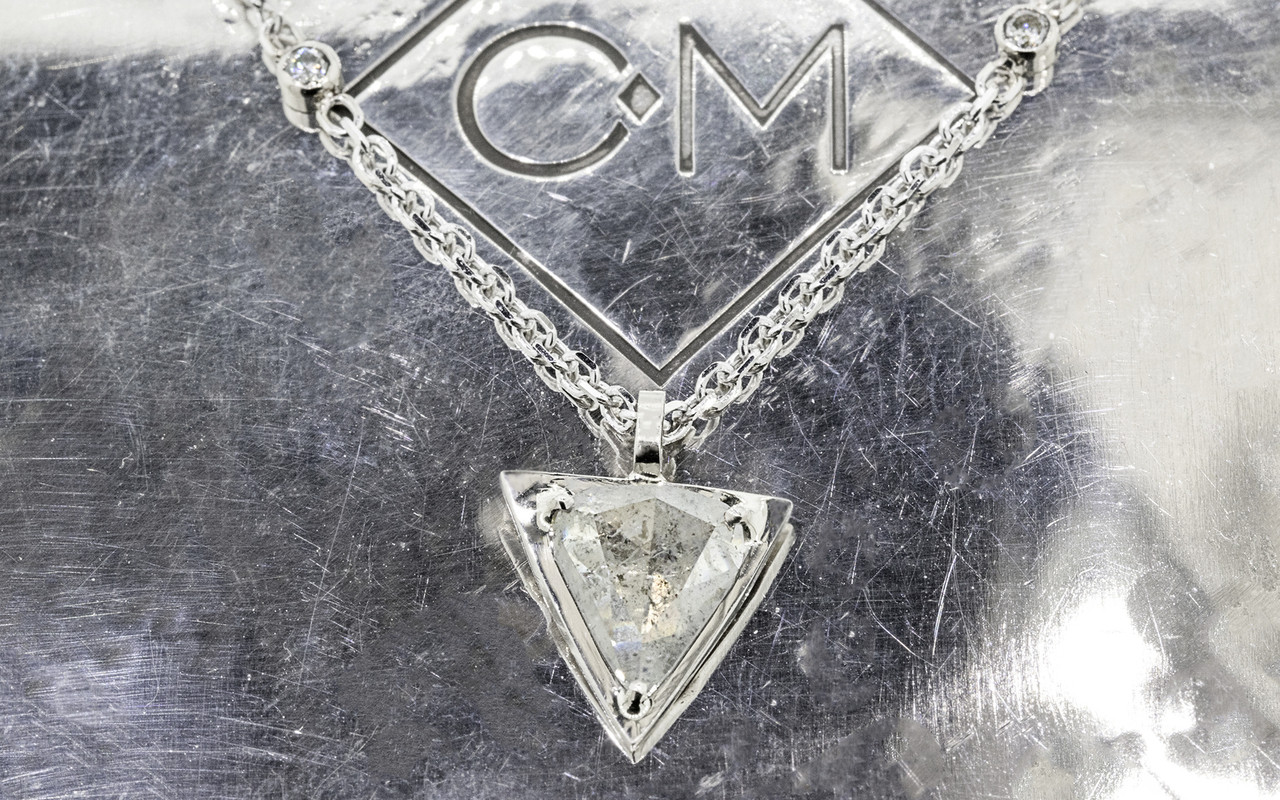 TOBA .79 carat triangle, rose-cut salt and pepper diamond necklace with two 2mm brilliant gray diamonds set into chain set in 14k white gold. Part of our New Classic Collection. Side view on metal background with Chinchar/Maloney logo