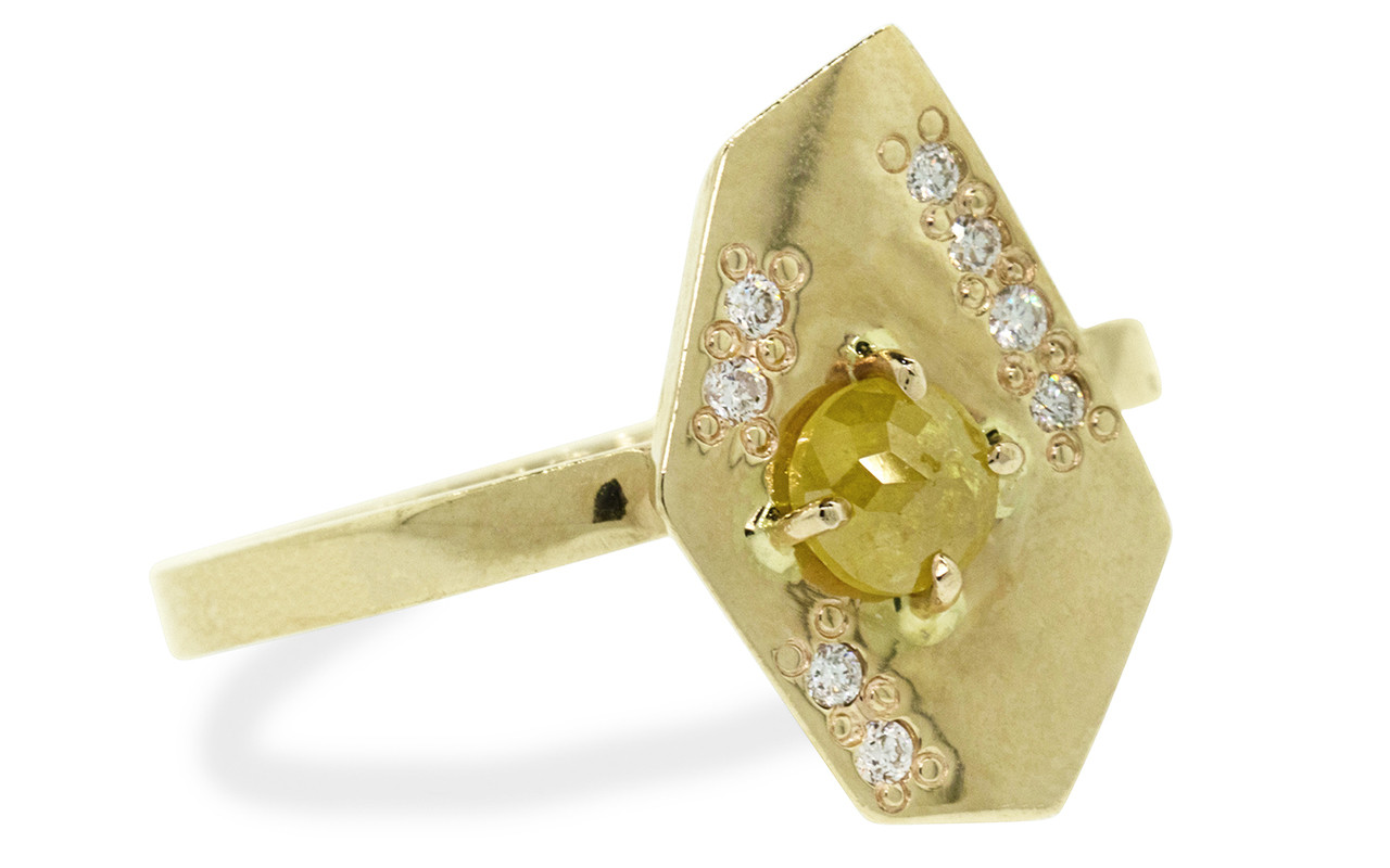 TOBA .33 carat rose-cut warm yellow diamond ring with eight 1mm brilliant white diamonds set into main setting on either side of main diamond set in 14k yellow gold flat band. Part of our New Classic Collection. 3/4 view on white background
