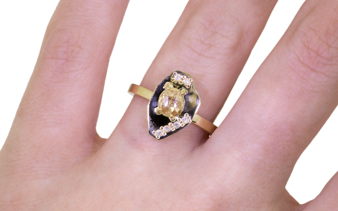 TOBA .41 carat rose-cut natural light champagne diamond ring with six 1mm brilliant white diamonds set into main setting on either side of main diamond set in 14k yellow gold flat band on a hand. Part of our New Classic Collection.