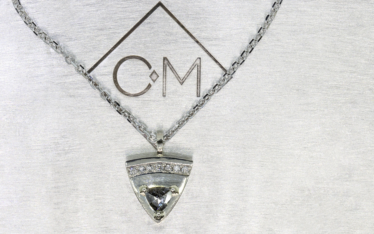 TOBA .18 carat triangle rose-cut salt and pepper diamond necklace with seven 1.25mm brilliant gray diamonds set across the top of the pendent set in 14k white gold with chain. Part of our New Classic Collection. Front view on metal background with Chinchar/Maloney logo