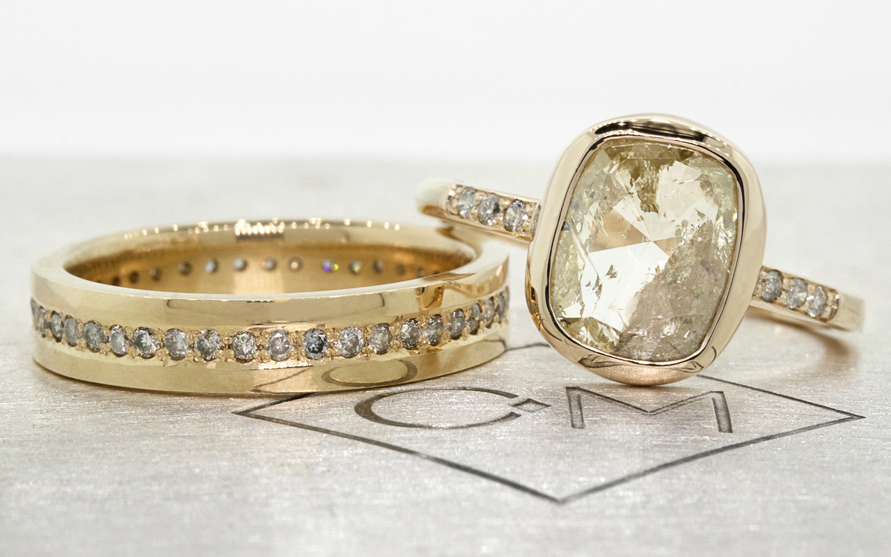 2.46 carat cushion, rose cut translucent rustic champagne/white bezel set diamond ring set in 14k yellow gold with six 1.2mm brilliant gray diamonds set in 1/2 round band. With Eternity Wedding Band with 1.2mm brilliant gray diamonds set in 14k yellow gold 4mm wide and 1.5mm thick flat band