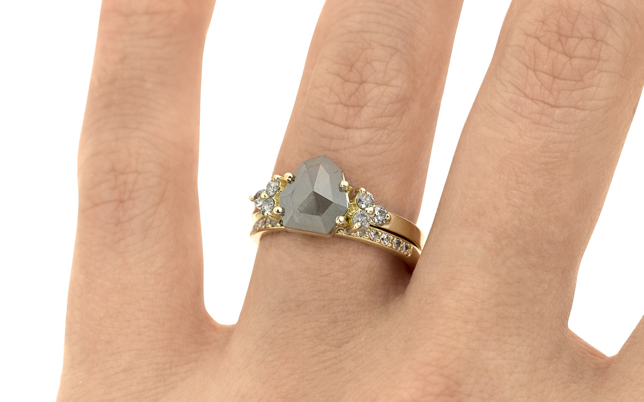 .94 carat Gray Center Diamond with three 2mm brilliant Gray diamond  clusters on each shoulder with Wedding Band with 16 Gray Diamonds on a hand.   The ring is made in 14k yellow gold.