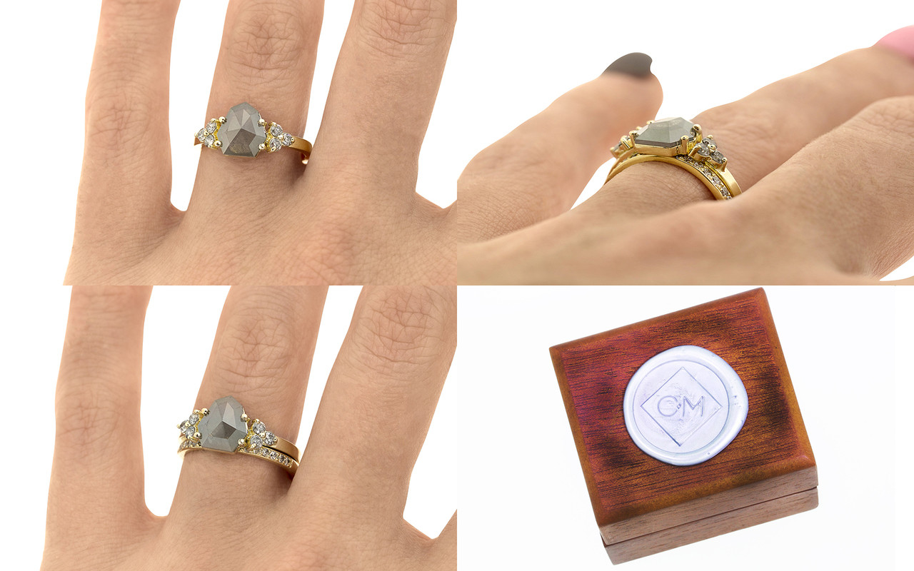 .94 carat Gray Center Diamond with three 2mm brilliant Gray diamond clusters on each shoulder with Wedding Band with 16 Gray Diamonds views on a hand with wooden box stamped with wax seal Chinchar/Maloney logo.   The ring is made in 14k yellow gold.