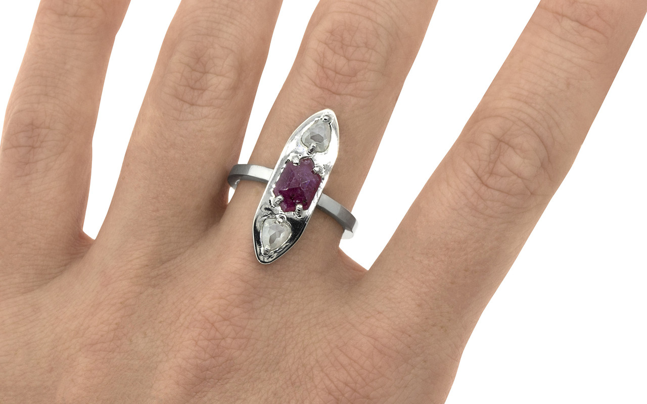 SANTORINI .55 carat pear rose cut icy white diamonds and .96 carat rose cut vibrant ruby set in 14k recycled white gold with our signature setting and 2mm flat band on a hand. Part of our New Classic Collection