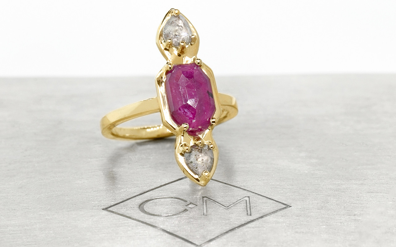 Santorini .59 carat pear rose cut sparkly salt and pepper diamonds and 2.08 carat fancy rose cut rich ruby set in 14k recycled yellow gold, set in our signature setting with 2mm flat band. Part of our New Classic Collection. 3/4 view on metal background with Chinchar/Maloney logo