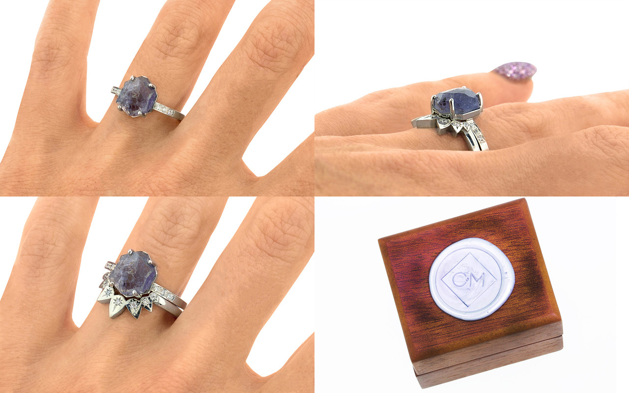 """one-of-a-kind, partially hand-cut and polished, 1.96 carat tanzanite ring. prongs in our original design have been inlaid into grooves carved into the gem for a secure and smooth setting. Six 1.2mm brilliant gray diamonds have been bead-set into the band on each side of the tanzanite. 14k recycled white 2mm wide flat gold band. With Pear Shadow Band features 7 brilliant white diamonds set in """"star"""" settings. 4k recycled white gold and 14k recycled rose gold this ring can also be made in 14k recycled yellow gold on a hand. With wooden box stamped with wax seal Chinchar/Maloney logo"""