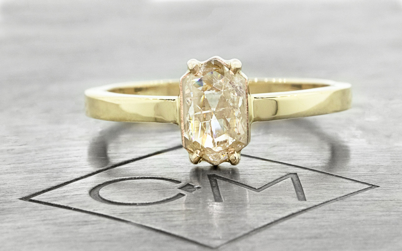 One of a kind, this .67ct diamond has a sparkling and translucent, light champagne color. hexagonal, fancy, rose cut diamond that measures 8mm x 5.25mm. 14k recycled yellow gold with a band that measures 2mm wide. Front view on metal background with Chinchar/Maloney logo