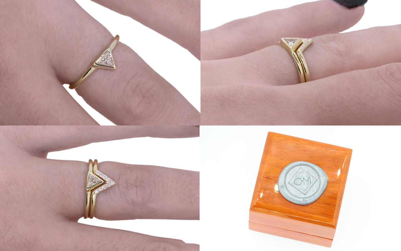 Wedding set in 14k yellow gold with .15 carat trillion white diamond in bezel setting.  A matching wedding band is stacked on top.  It is triangular and has small brilliant white diamonds set in it.  Modeled on a hand with wooden ring box with Chinchar/Maloney wax seal logo.