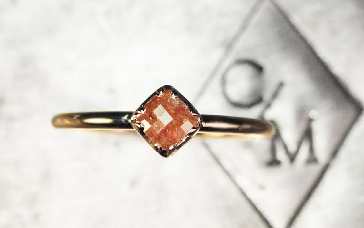 .39 carat cushion, rose cut dark honey diamond bezel set ring set  in 14k yellow gold 1/2 round band. top view on metal background with Chinchar/Maloney logo