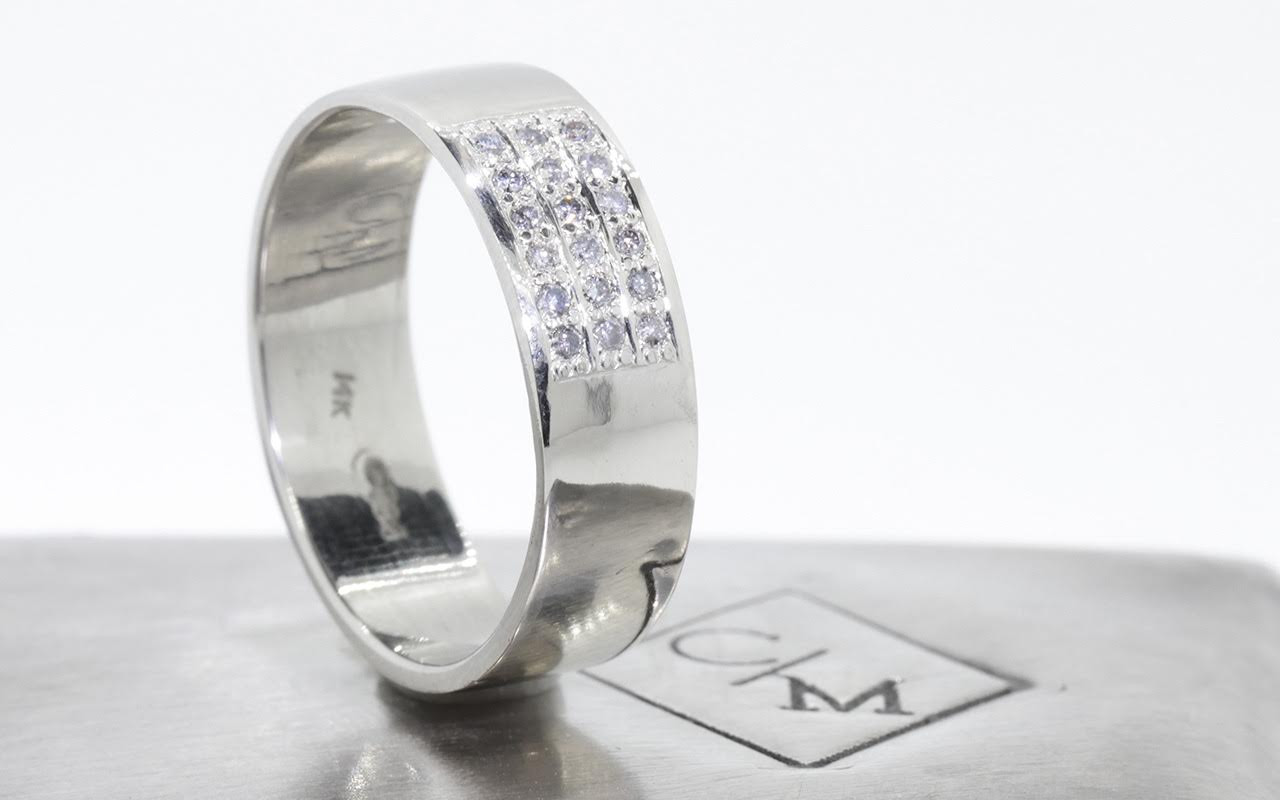 6.5mm wide flat wedding band 14k white gold with a block of pave set gray diamonds on the top.  Side view metal background with Chinchar/Maloney logo.