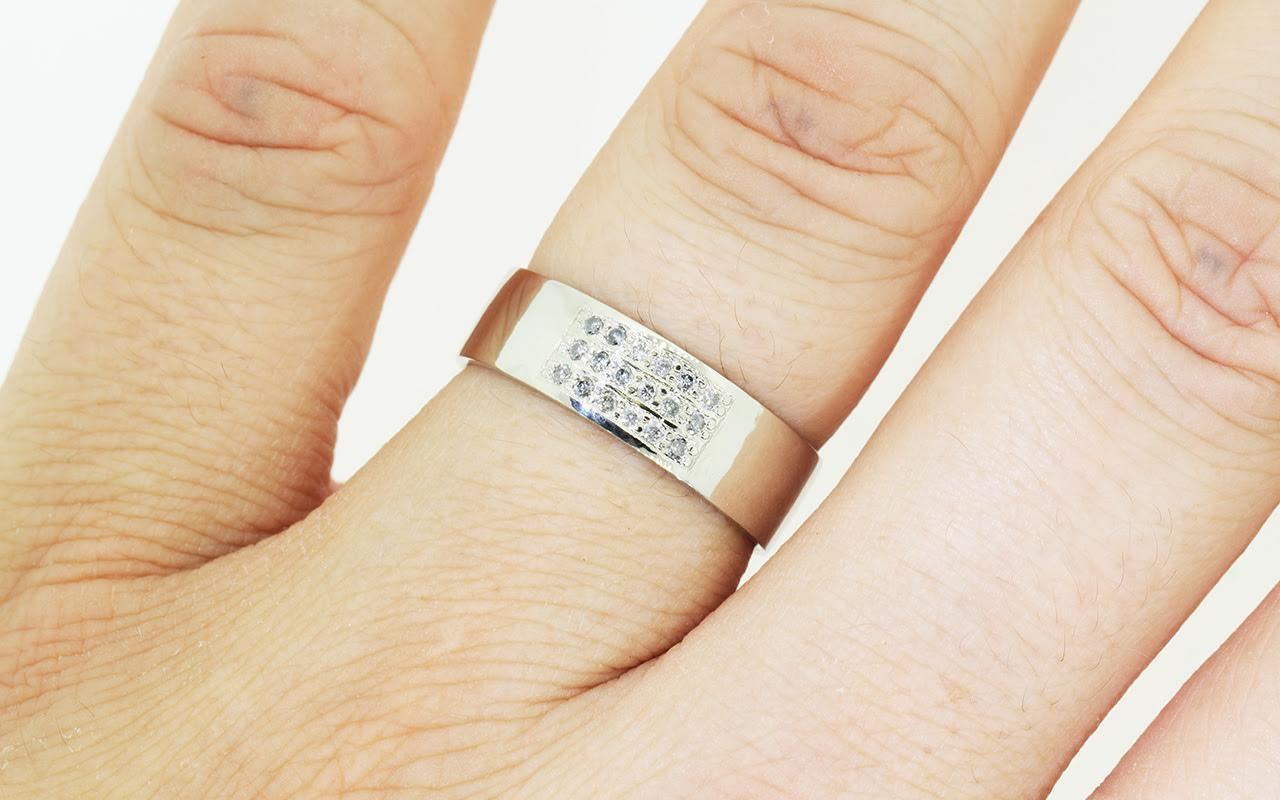 6.5mm wide flat wedding band 14k white gold with a block of pave set gray diamonds on the top.  Modeled on a hand.