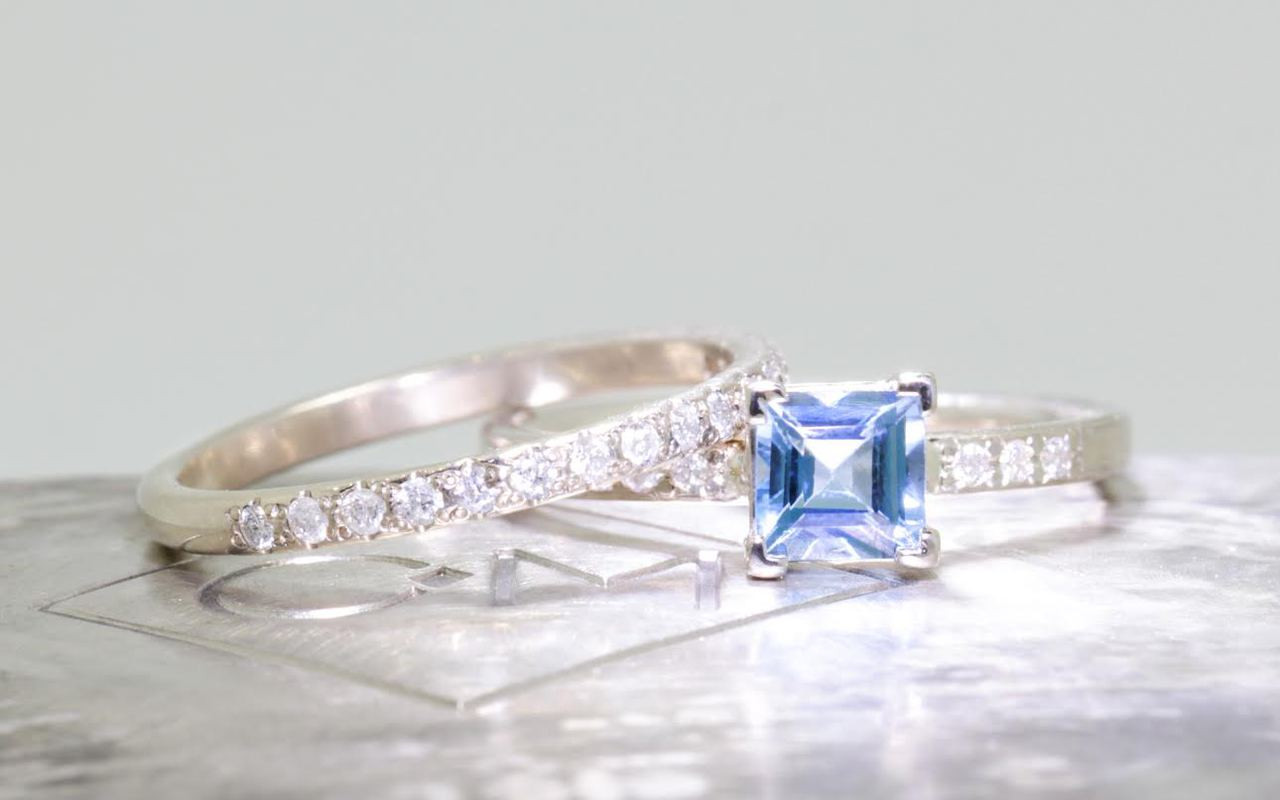 .58 carat aquamarine in  14k white gold six 1.2mm brilliant white diamonds set in band with Wedding Band with 16 white Diamonds