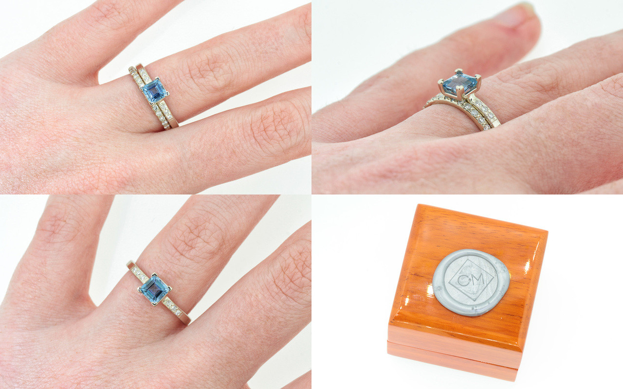 .58 carat aquamarine in  14k white gold six 1.2mm brilliant white diamonds set in band with 14k white gold Wedding Band with 16 white Diamonds on a hand with wooden box stamped with wax seal Chinchar/Maloney logo
