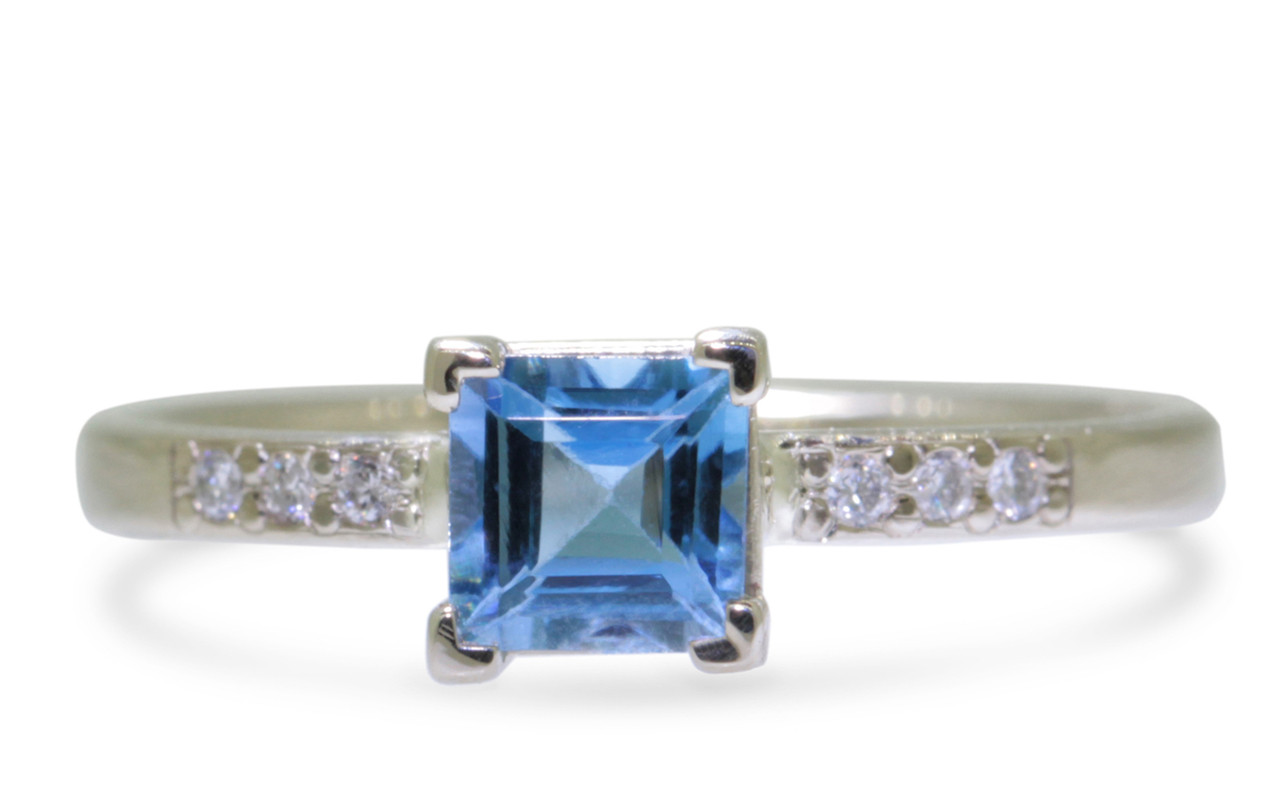 .58 carat aquamarine in  14k white gold six 1.2mm brilliant white diamonds set in band front view on white background