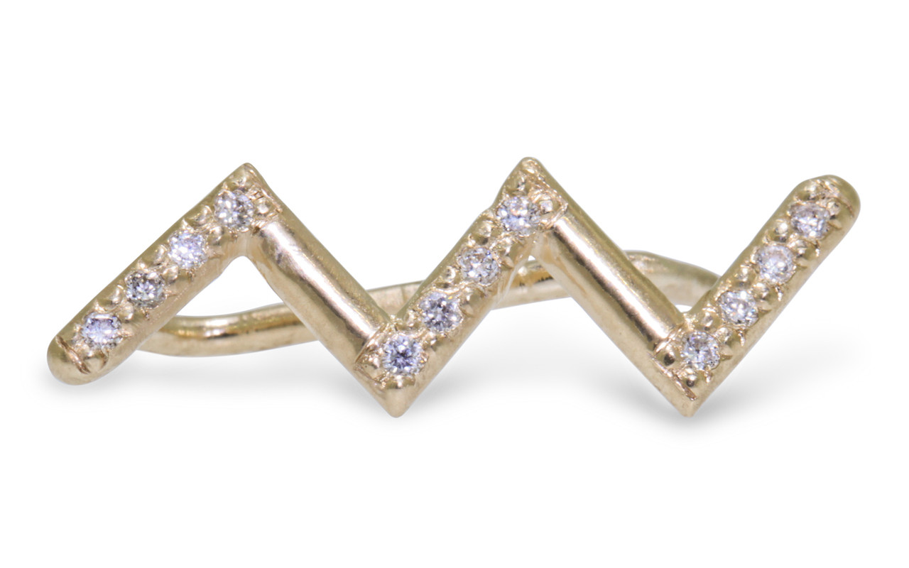 Ear climber in zig zag shape in 14k yellow gold.  Small brilliant round white diamonds are set in three sections of the earring.  Front view of one earring on white background.