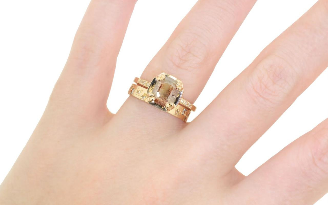 AIRA .62 carat round rose cut icy white diamond prong set in 14k yellow gold geometric octangular setting. Six 1.2mm brilliant champagne diamonds set in 14k yellow gold band. New Classic Collection. Modeled on hand with organic pave wedding band.