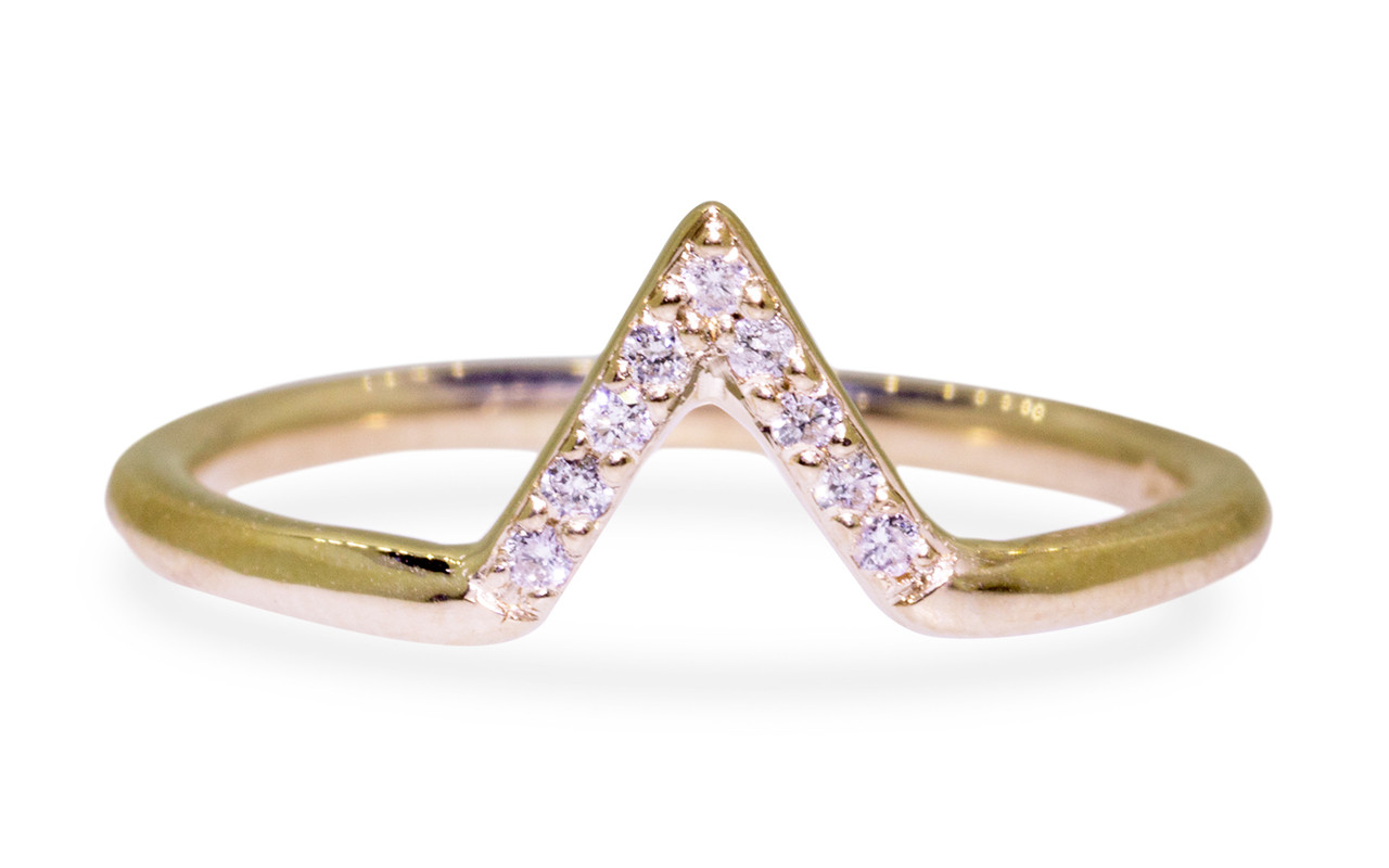 Diamond band in 14k yellow gold.  Center is in triangle shape and set with small, round brilliant white diamonds.  Front view on white background.