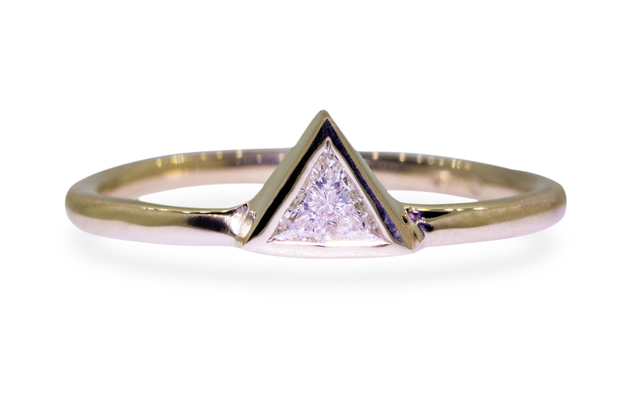 .12 carat trillion white diamond solitaire set in 14k yellow gold.  This gold band.  Front view on white background.