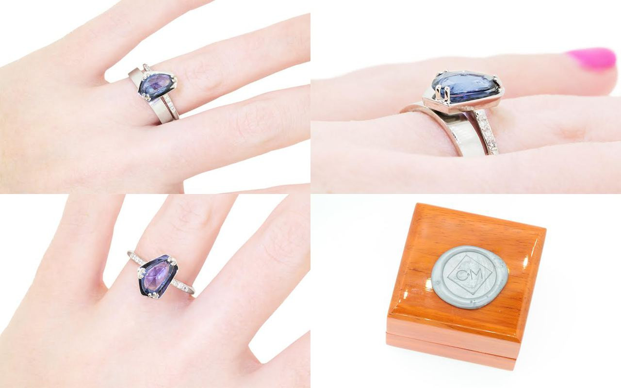 KIKAI 1.88 carat free form rose cut blue sapphire with six 1.2mm brilliant white diamonds set in 14k white gold 1/2 round band. With 4mm flat band Wedding Band in 14k white gold on a hand with wooden box stamped with wax seal Chinchar/Maloney logo. Part of New Classic Collection