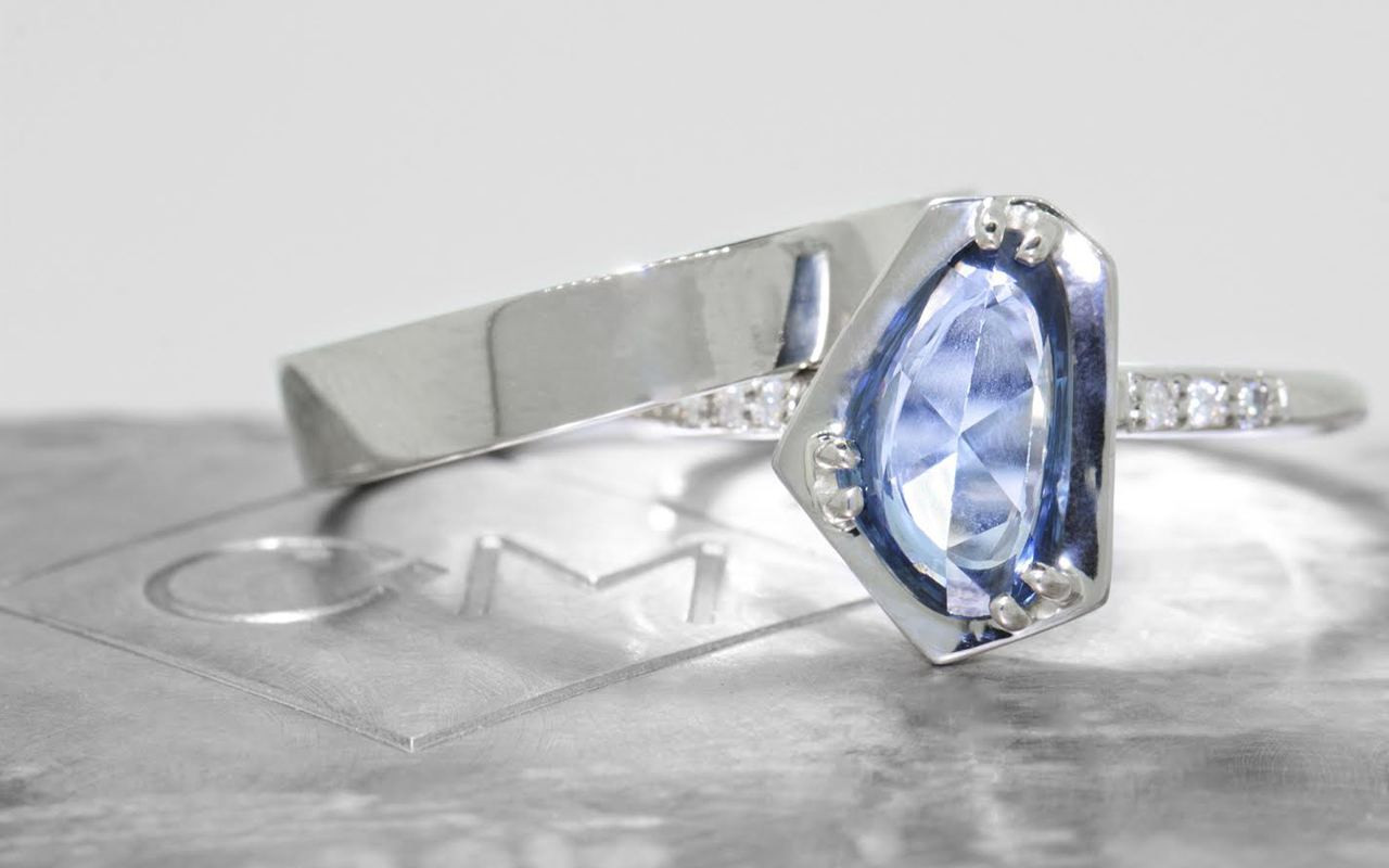 KIKAI 1.88 carat free form rose cut blue sapphire with six 1.2mm brilliant white diamonds set in 14k white gold 1/2 round band. With 4mm flat band Wedding Band in 14k white gold. Part of New Classic Collection