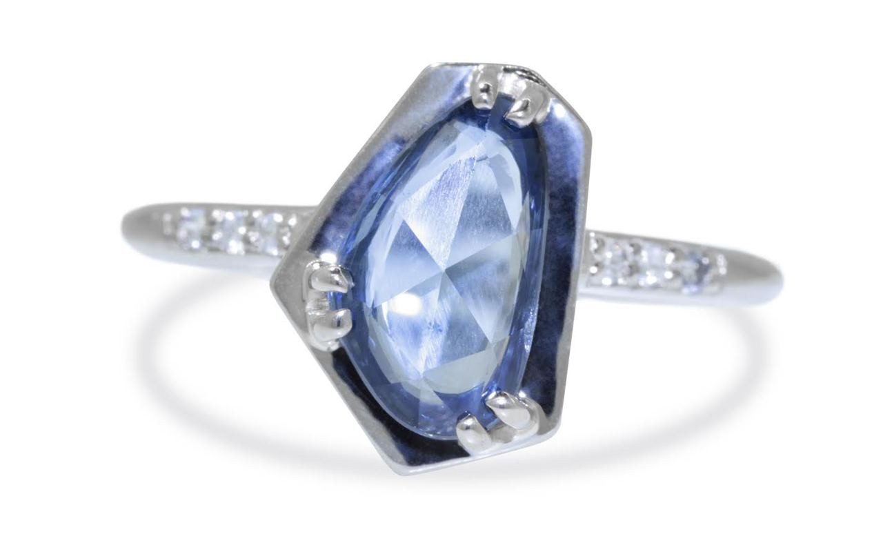 KIKAI 1.88 carat free form rose cut blue sapphire with six 1.2mm brilliant white diamonds set in 14k white gold 1/2 round band. Part of New Classic Collection. Front view on white background