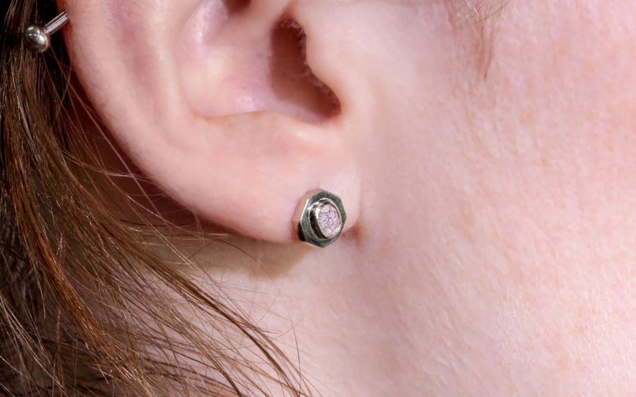Askja 14k white gold stud earrings. .45 carat pink purple diamonds bezel set in hexagon setting. Modeled on ear