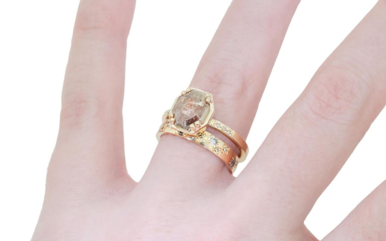 AIRA 1.49 carat cognac champagne hexagon cut prong set in 14k yellow gold geometric octangular setting. 1.2mm brilliant champagne pave diamonds set in 14k  yellow gold band. New Classic Collection. Modeled on hand with 14k gold eternity pave diamond wedding band.