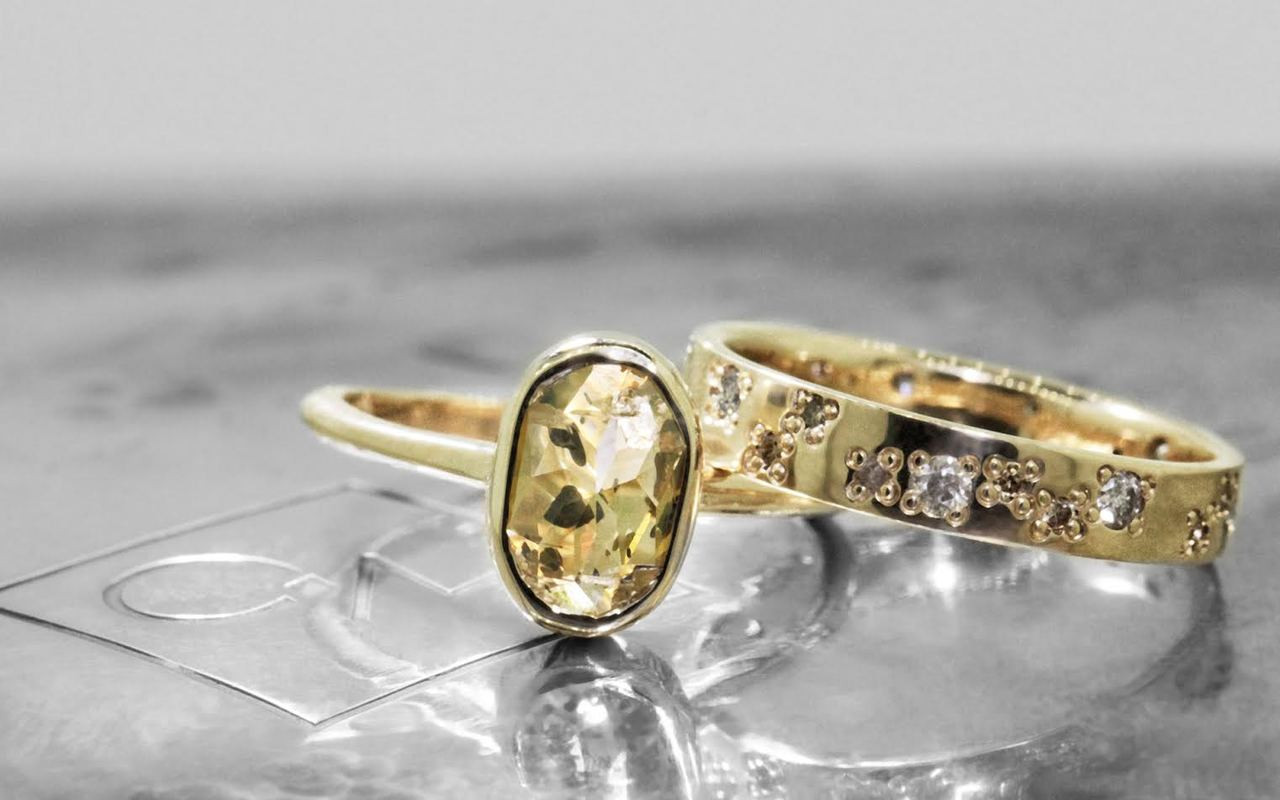 2.23 carat oval, rose cut champagne and pepper bezel set diamond ring set in 14k yellow gold 1/2 round band. With Organic Wedding Band with 1.2mm brilliant white, champagne and gray diamonds set in 14k yellow gold 4mm wide and 1.5mm thick flat band