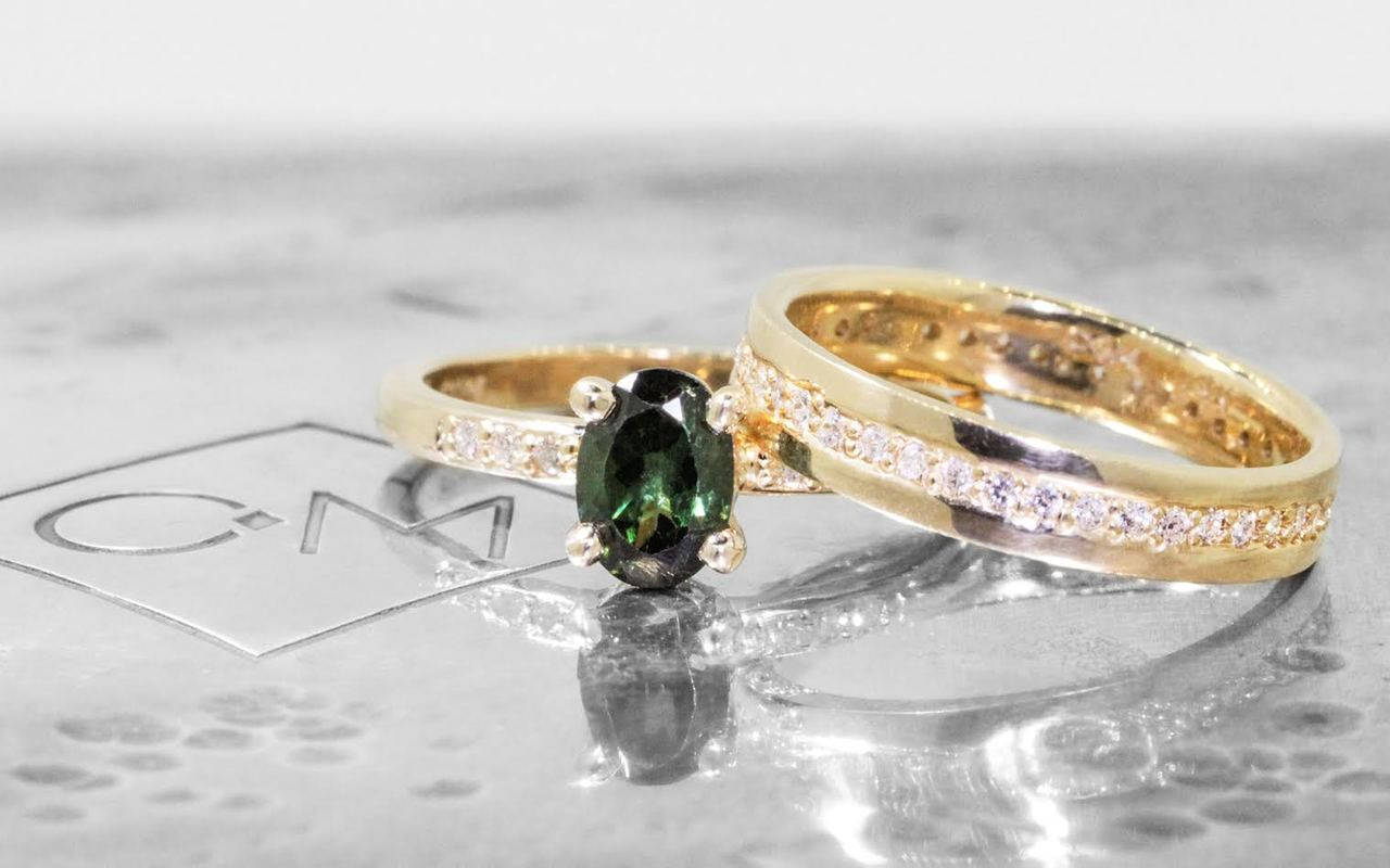 .80 carat green oval faceted tourmaline with six 1.2mm brilliant white diamonds set in 14k yellow gold 1/2 round band. with Eternity wedding band with brilliant white diamonds in 14k yellow gold