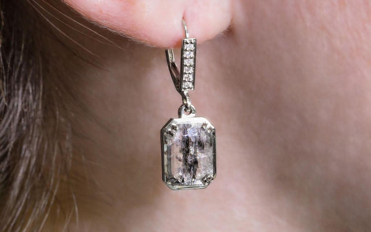 Edziza 14k white gold dangle earrings. 2.47 carat stripped salt and pepper diamonds prong set onto ocangular setting. 6 brilliant white diamonds set into lever back. modeled on ear