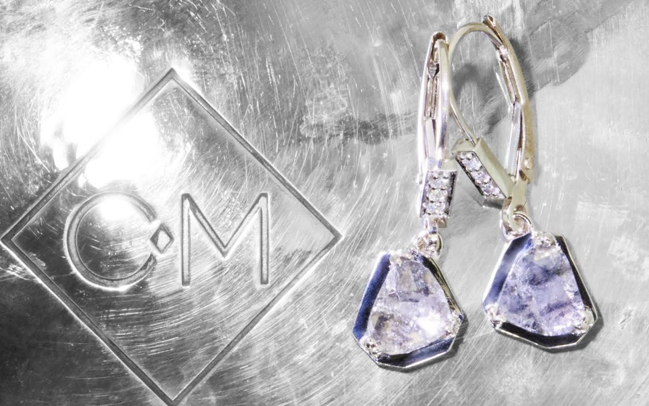 EDZIZA 14k white gold lever back dangle earrings with .84 carat free form salt and pepper diamonds prong set into geometric setting. Three brilliant white diamonds set into lever back. On metal background with Chinchar/Maloney logo