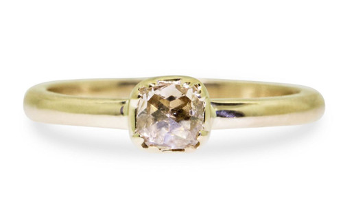 .45 carat cushion, rose cut luminous champagne diamond ring set in 14k yellow gold 1/2 round band. Front view on white background