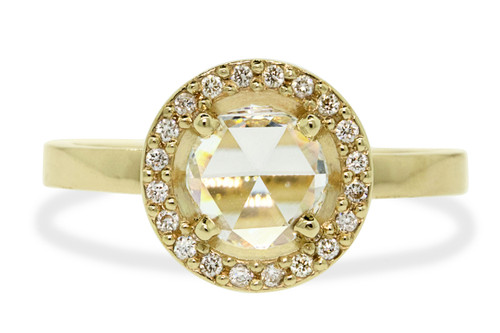 .87 carat rose cut rustic white prong set diamond ring with twenty brilliant white diamond halo set in 14k yellow gold flat band. Front view on white background