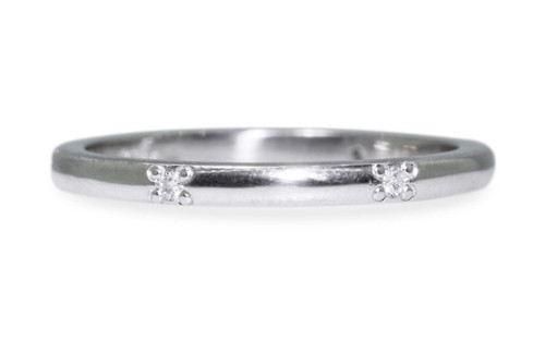 14k white gold wedding band with six brilliant white pave diamonds in band on white background