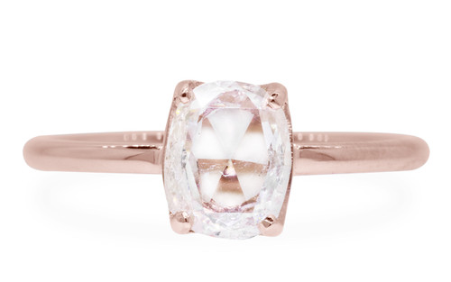 1 carat rose-cut translucent rustic white prong set diamond ring set in 14k rose gold 1/2 round band. Front view on white background
