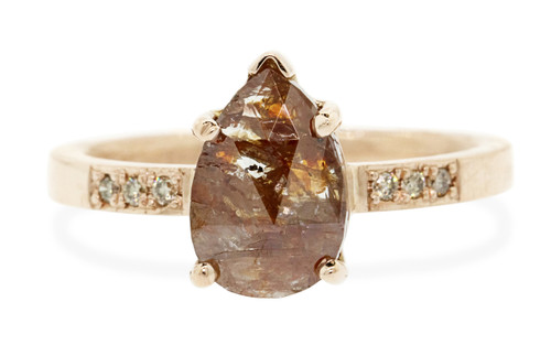 2.03 carat pear, rose cut rustic cognac prong set diamond ring set in 14k rose gold with six 1.2mm brilliant champagne diamonds set in flat band. Front view on white background