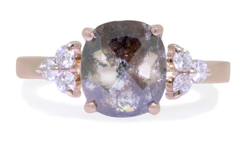 1.51 carat cushion, rose-cut translucent salt and pepper prong set diamond ring set in 14k rose gold with six 2mm brilliant white diamond clusters on either side of main setting flat band. Front view on white background