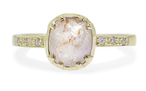 1.45 carat cushion, rose cut light peach prong/bezel set diamond ring set in 24k yellow gold with six 1.2mm brilliant white diamonds set into flat band. Front view on white background